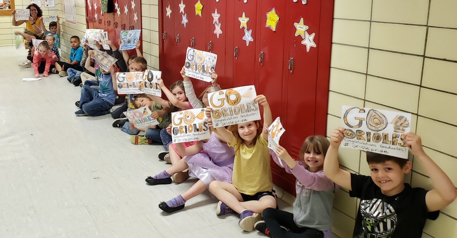 "Galewood students in hallway holding ""Go Orioles"" signs"