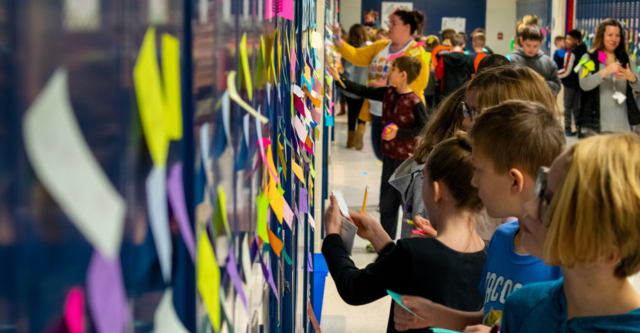 Positive Post-it day hallway